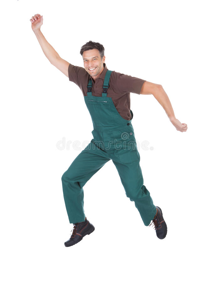 Excited male gardener. Portrait Of Excited Mature Male Gardener With Hand Raised royalty free stock photos