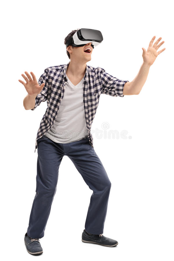Excited man experiencing virtual reality. Full length portrait of young excited man experiencing virtual reality isolated on white background royalty free stock images