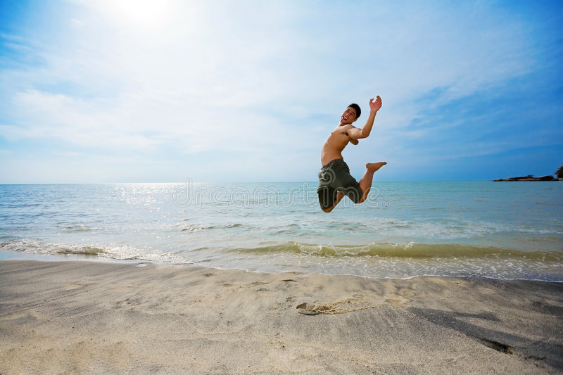 Download Excited man jumping stock photo. Image of blue, excited - 4569088