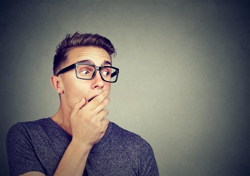 Excited man listening to gossips stock photo
