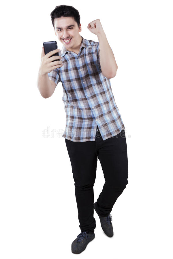 Excited man reading good news stock photography