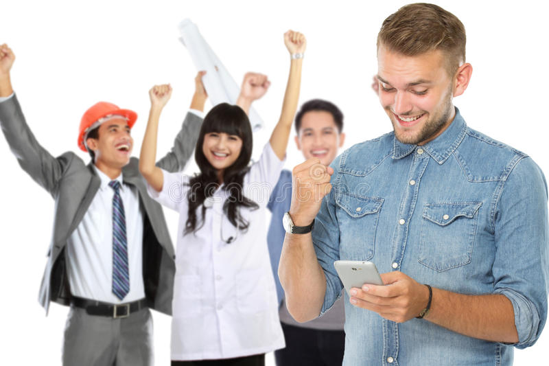 Excited man receiving a text message stock photography