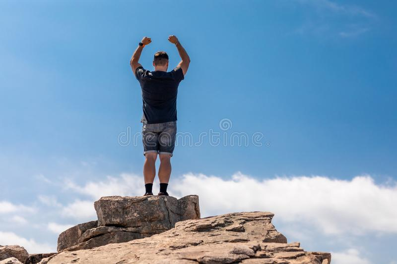 Excited Man On Top In A Beautiful Summer Landscape stock image