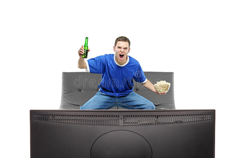 Excited man watching sport on a TV