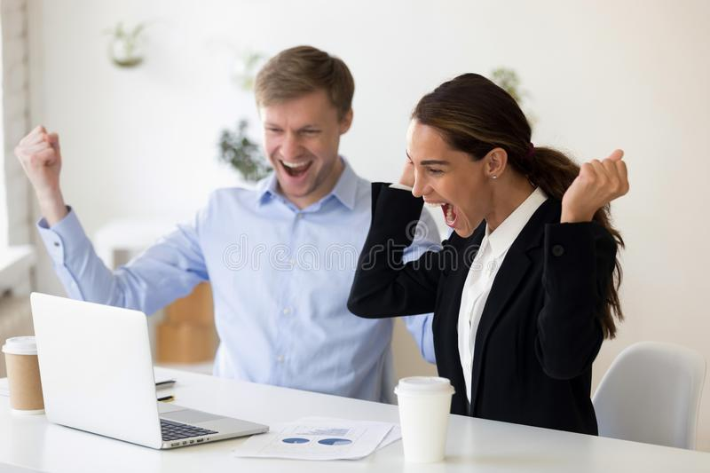 Excited man and woman clenching fists after successful job interview. Career, office and placement concept - excited men and women rejoicing clenching fists royalty free stock photos