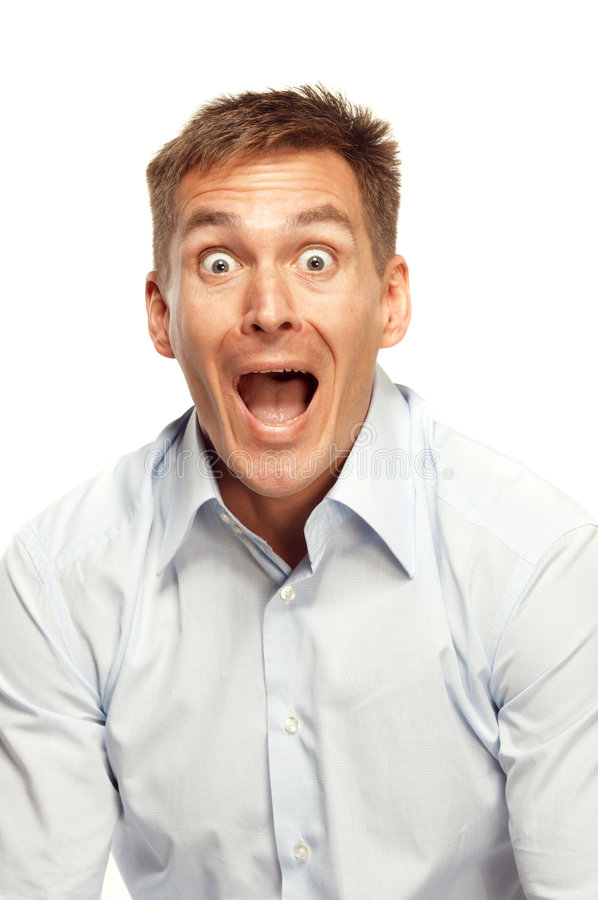 Excited man yelling. A studio portrait of an excited man with eyes and mouth wide open as if yelling loudly stock photography