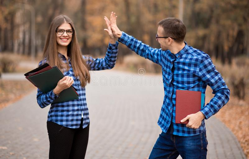 Excited man and woman screaming with joy raising hands, happy young couple celebrate online win victory, goal achievement. Excited men and women screaming with royalty free stock photography