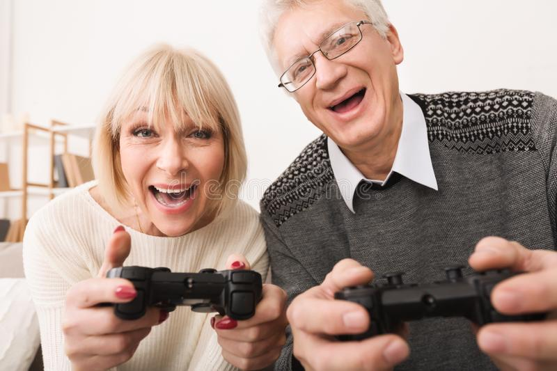 Excited Middle-Aged Couple Playing Video Games, Closeup royalty free stock photo