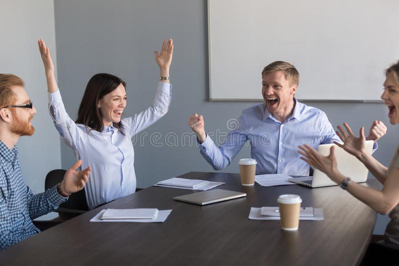 Excited motivated team coworkers celebrating unbelievable busine royalty free stock photos