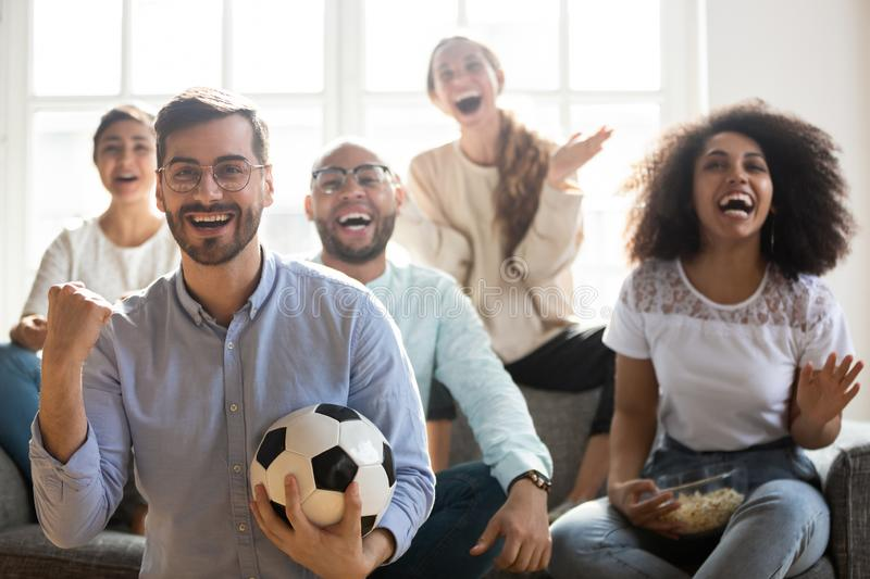 Excited multiracial young people cheering team watching football online royalty free stock photography