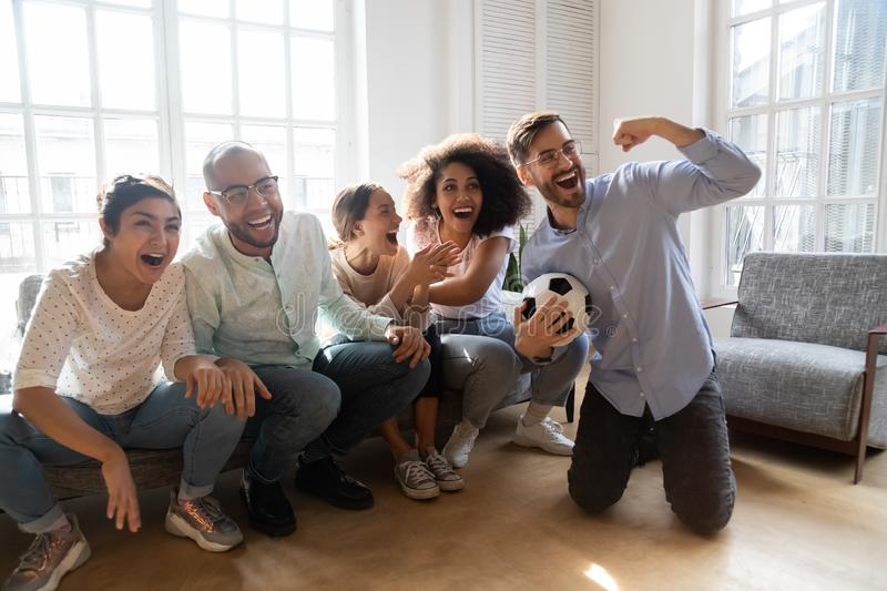 Excited multiracial millennial people watch football cheering royalty free stock photos