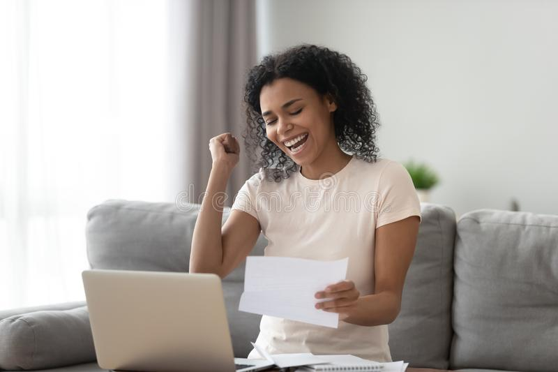 Excited overjoyed black girl student read good news in letter royalty free stock photos