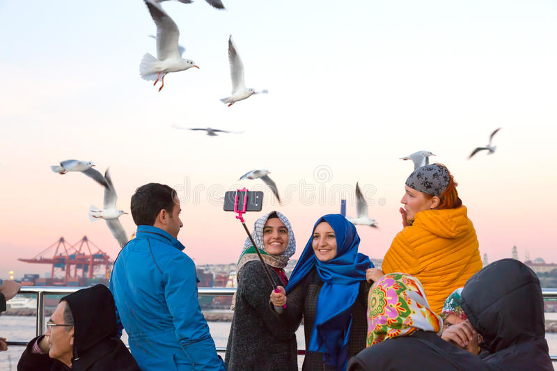 Excited People feeding Sea Gulls chasing Ferry Boat stock images
