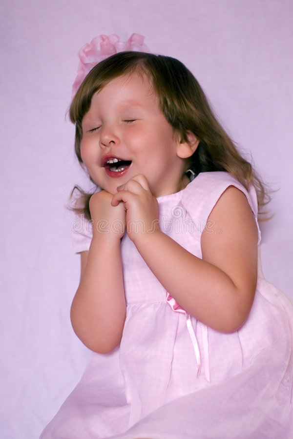 Excited pink girl with bow stock images