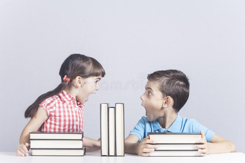 Excited school kids having a funny reaction stock images