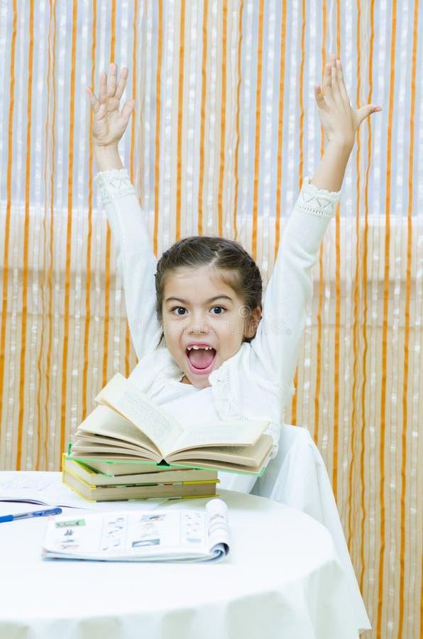 Schoolgirl at her Desk stock image