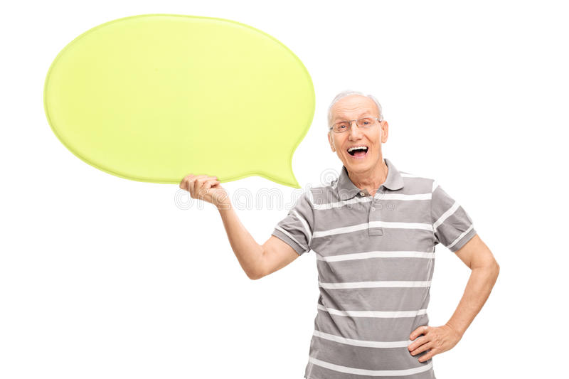 Excited senior holding a big speech bubble stock image