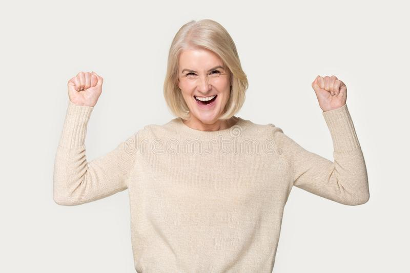 Excited senior woman feel euphoric with lottery win stock photos