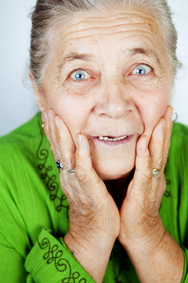 Excited senior woman with surprise expression stock images