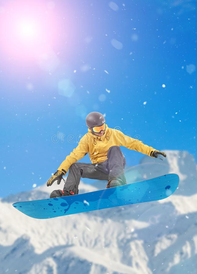 Excited snowboarder in the mountains stock images