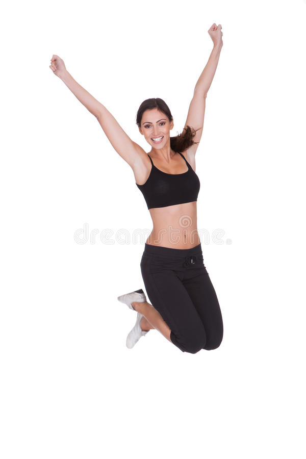 Excited Sporty Woman Jumping Stock Photo