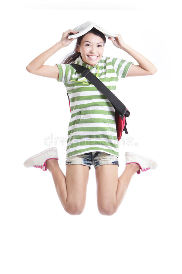 Excited Student Girl Jumping With Book Stock Photo
