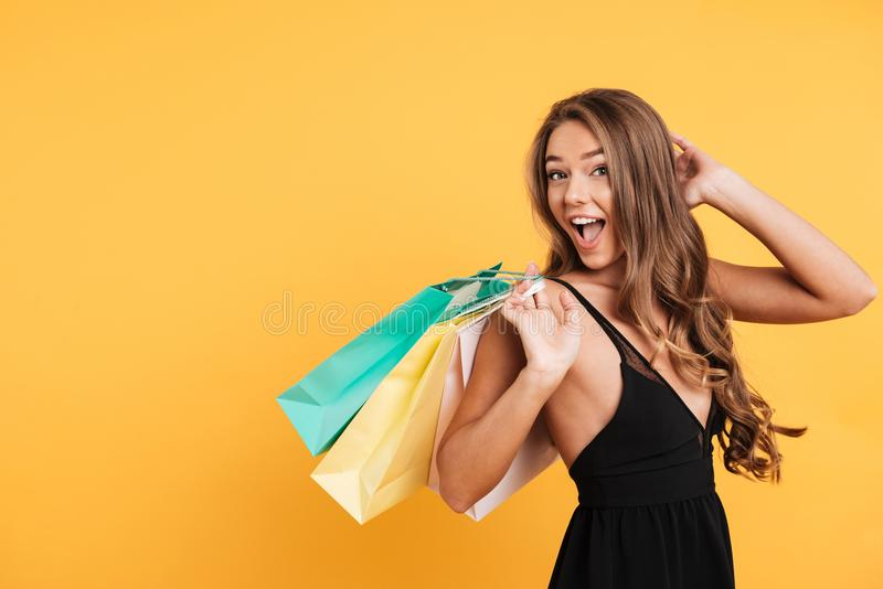 Excited surprised young lady holding shopping bags. stock photography