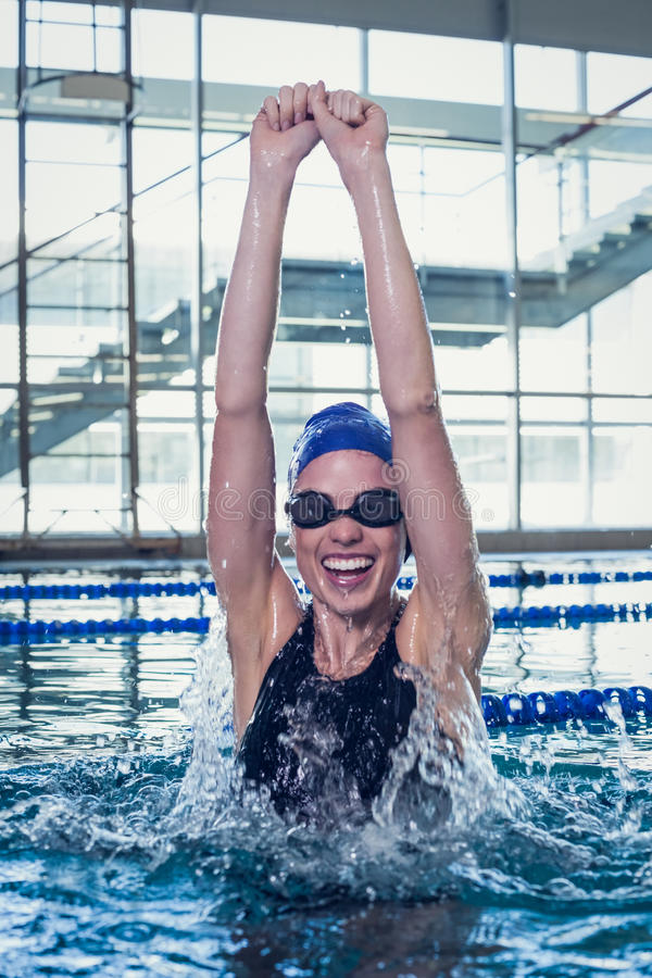 Excited swimmer cheering in the swimming pool royalty free stock photography