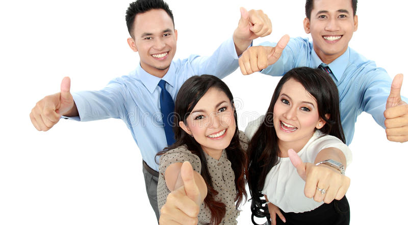 Excited team showing thumbs up stock photography