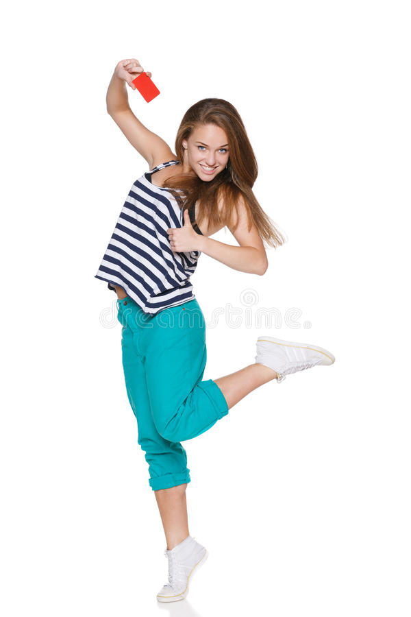 Excited teen girl smiling showing credit card royalty free stock photos