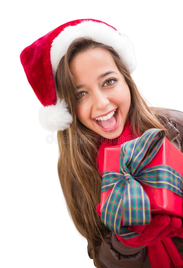 Excited Teen Wearing A Christmas Santa Hat with Bow Wrapped Gift Iisolat. Girl Wearing A Christmas Santa Hat with Bow Wrapped Gift Iisolated on White stock photography