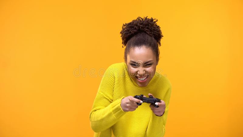 Excited teenager playing video game by console, modern technology, entertainment. Stock photo royalty free stock photos