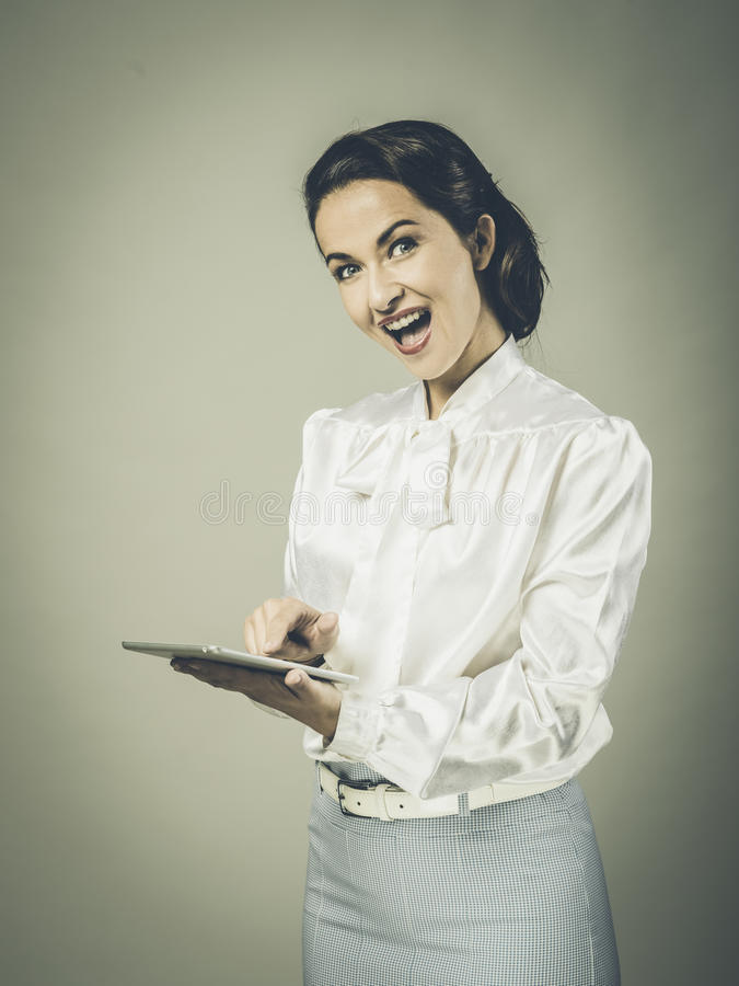 Excited vintage woman with tablet stock images