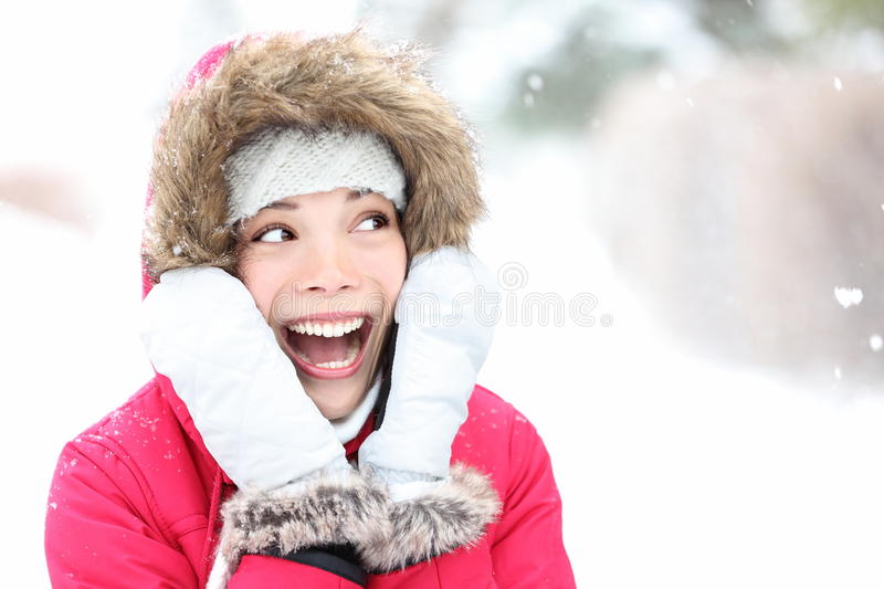 Excited winter woman looking to side royalty free stock photo