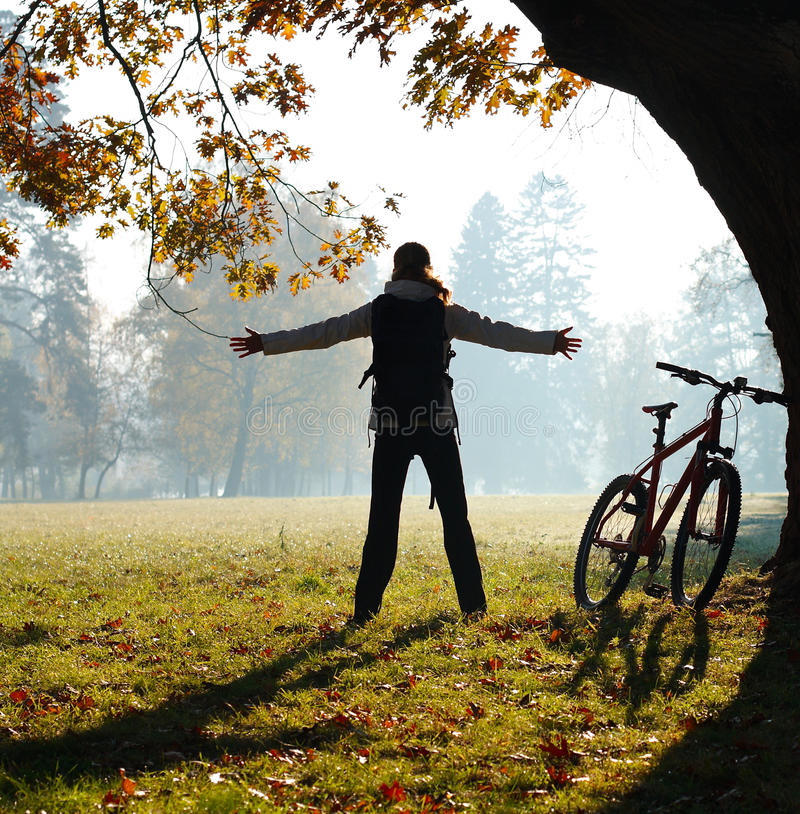 Download Excited Woman Cyclist Standing In A Park Stock Photo - Image: 23347848