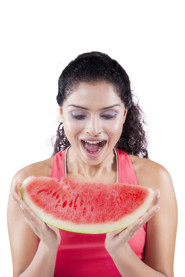 Excited woman eating juicy watermelon stock image