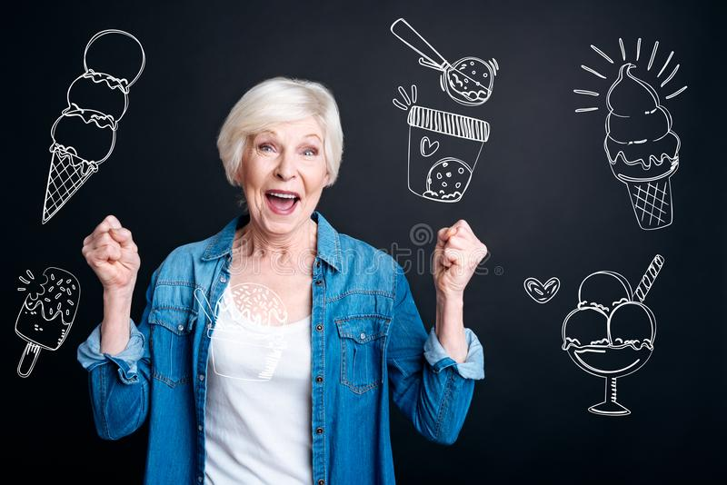 Excited woman feeling happy while choosing ice cream in a cafe royalty free stock photos