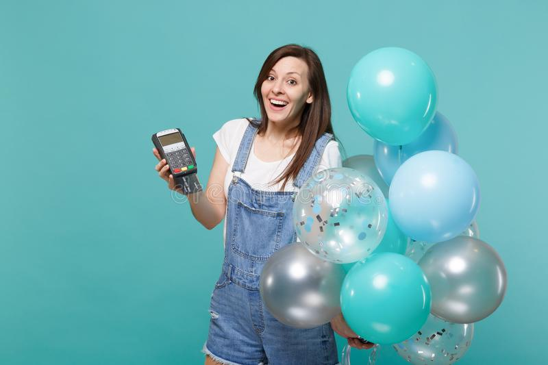 Excited woman hold wireless modern bank payment terminal to process, acquire credit card payments, colorful air balloons stock photos