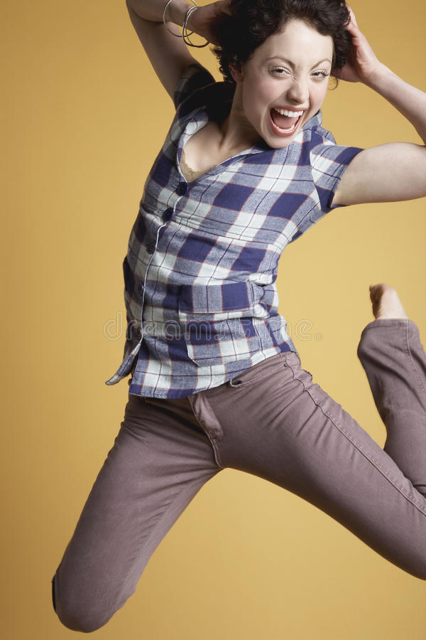 Download Excited Woman Jumping And Screaming Stock Photo - Image: 33890628