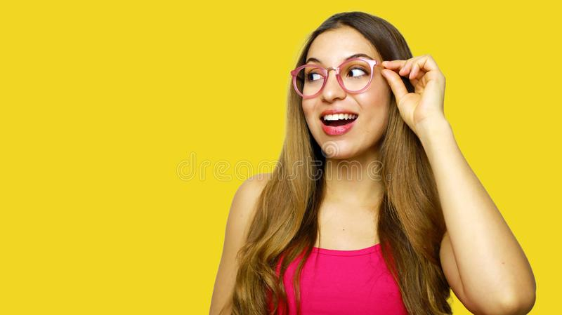 Excited woman looking sideways screaming of joy. Closeup of happy fashion girl  on yellow background royalty free stock photography