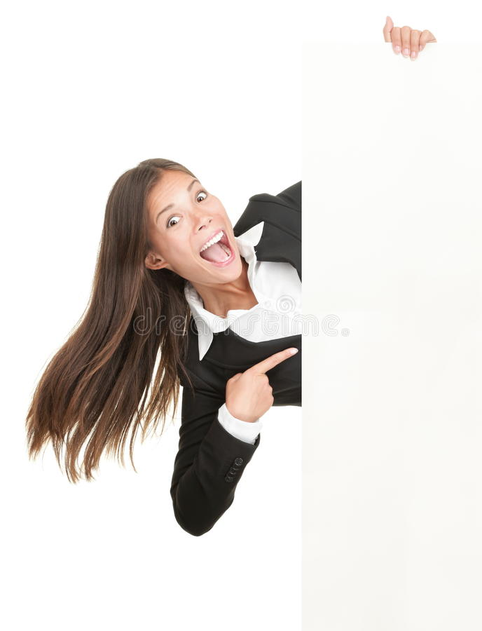 Excited woman pointing at sign stock image