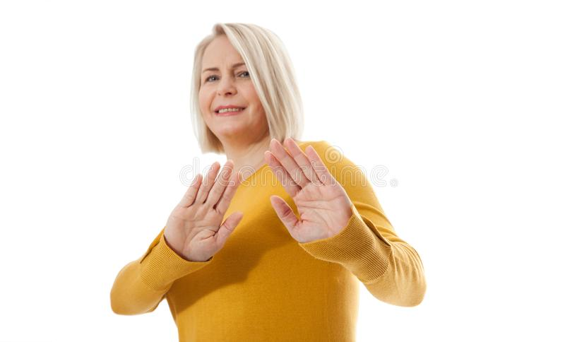 Excited woman showing the sign of stop, neglect, negation and reluctance royalty free stock photo