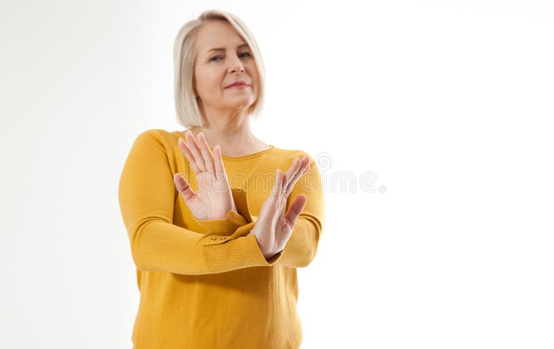 Excited woman showing the sign of stop, neglect, negation and reluctance stock photos