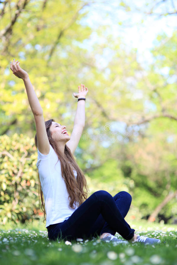 Download Excited Woman Sitting With Arms Raised Stock Photo - Image: 25247334
