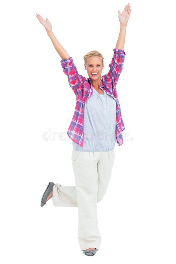 Excited Woman Standing With Hands And Foot Up In Air Royalty Free Stock Image