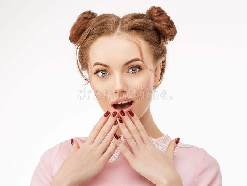 Excited woman surprise holds cheeks by hand. Looking camera. Exp. Ressive facial expressions. Isolated on white background stock photos