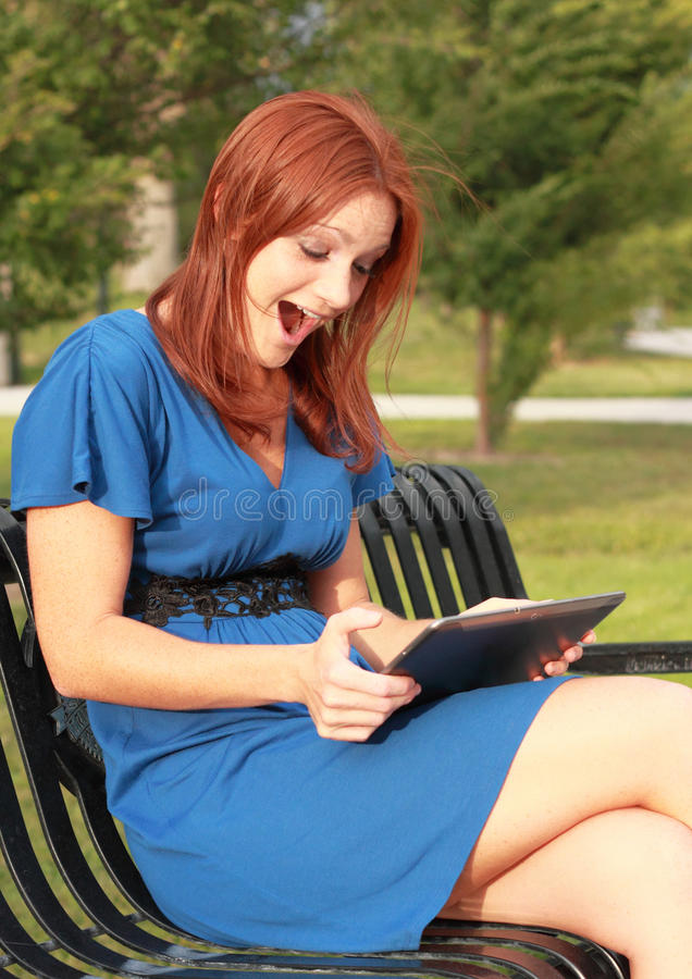 Excited woman with tablet royalty free stock photos