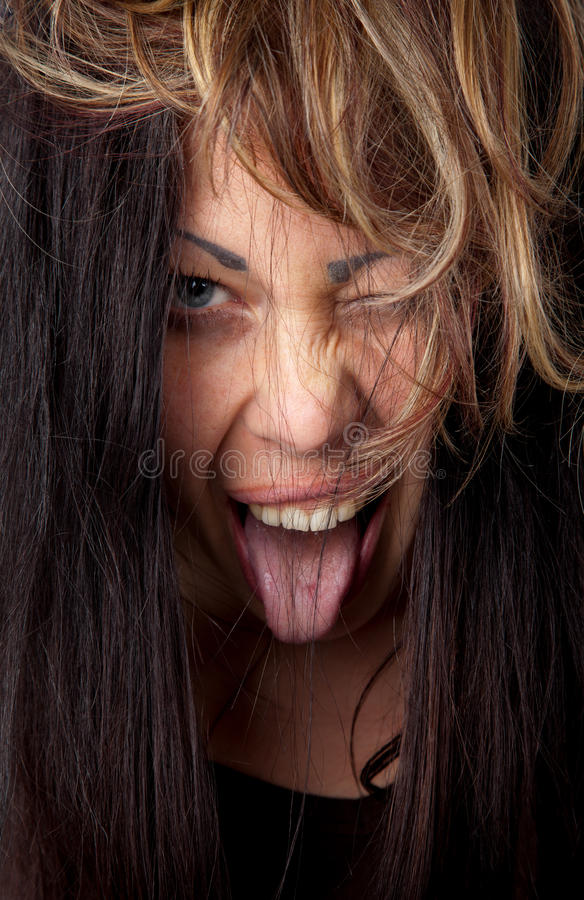 Download Excited Woman With Tongue Out Stock Image - Image of tousled, face: 23026089