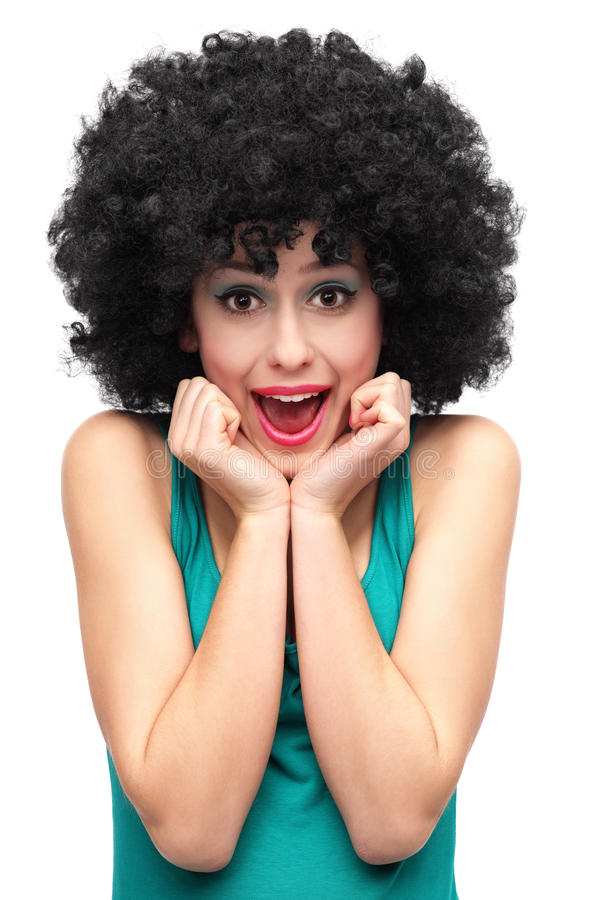 Excited woman wearing afro wig