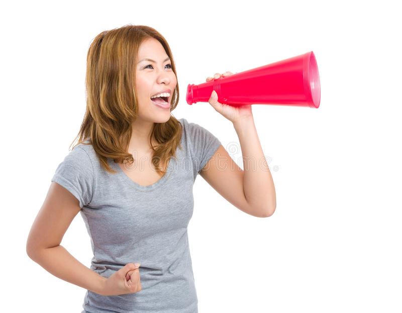 Excited woman yelling with megaphone stock photos